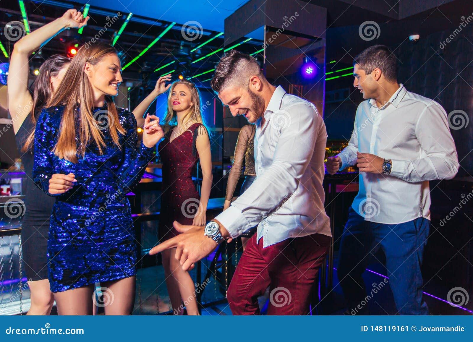 Friends partying in a nightclub