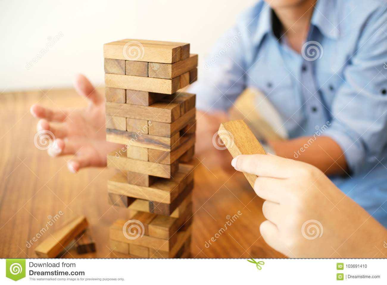 Group Of Friends Playing Blocks Wood Game On The Table Folded Pu Stock Photo Image Of Blocks Carefree 103691410