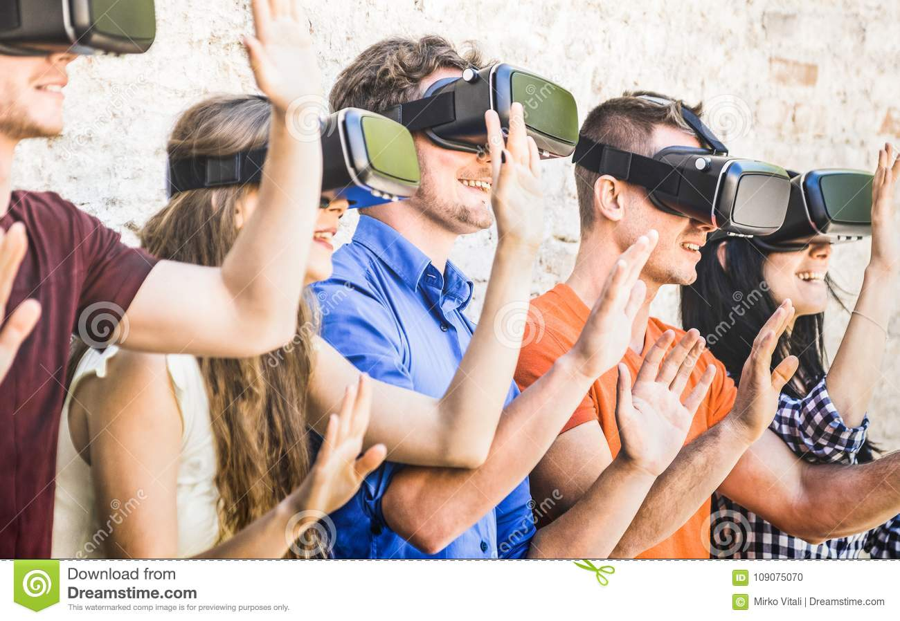 Group of friends playing on virtual reality vr goggles