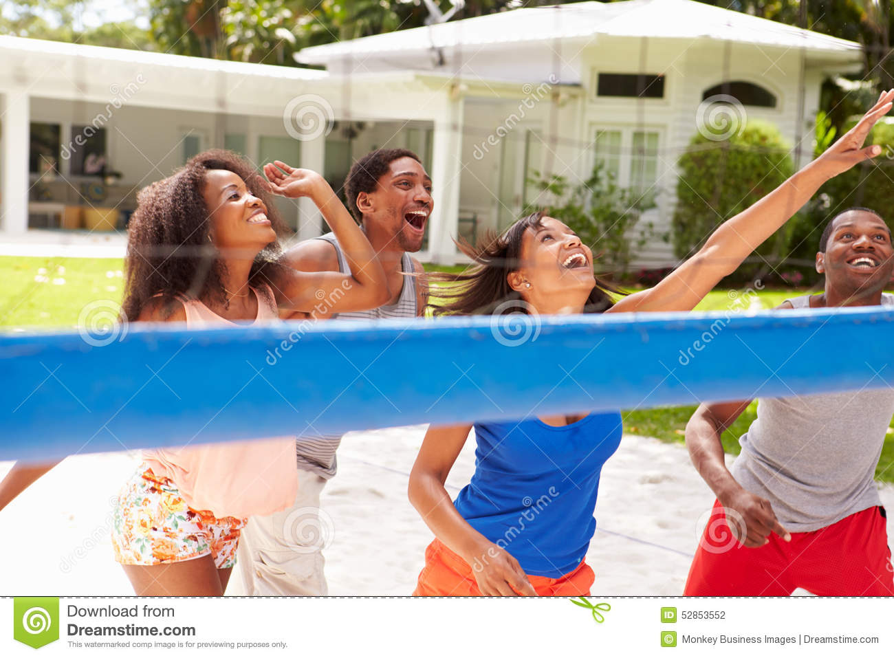 Group Of Friends Playing Volleyball Match Stock Photo ...