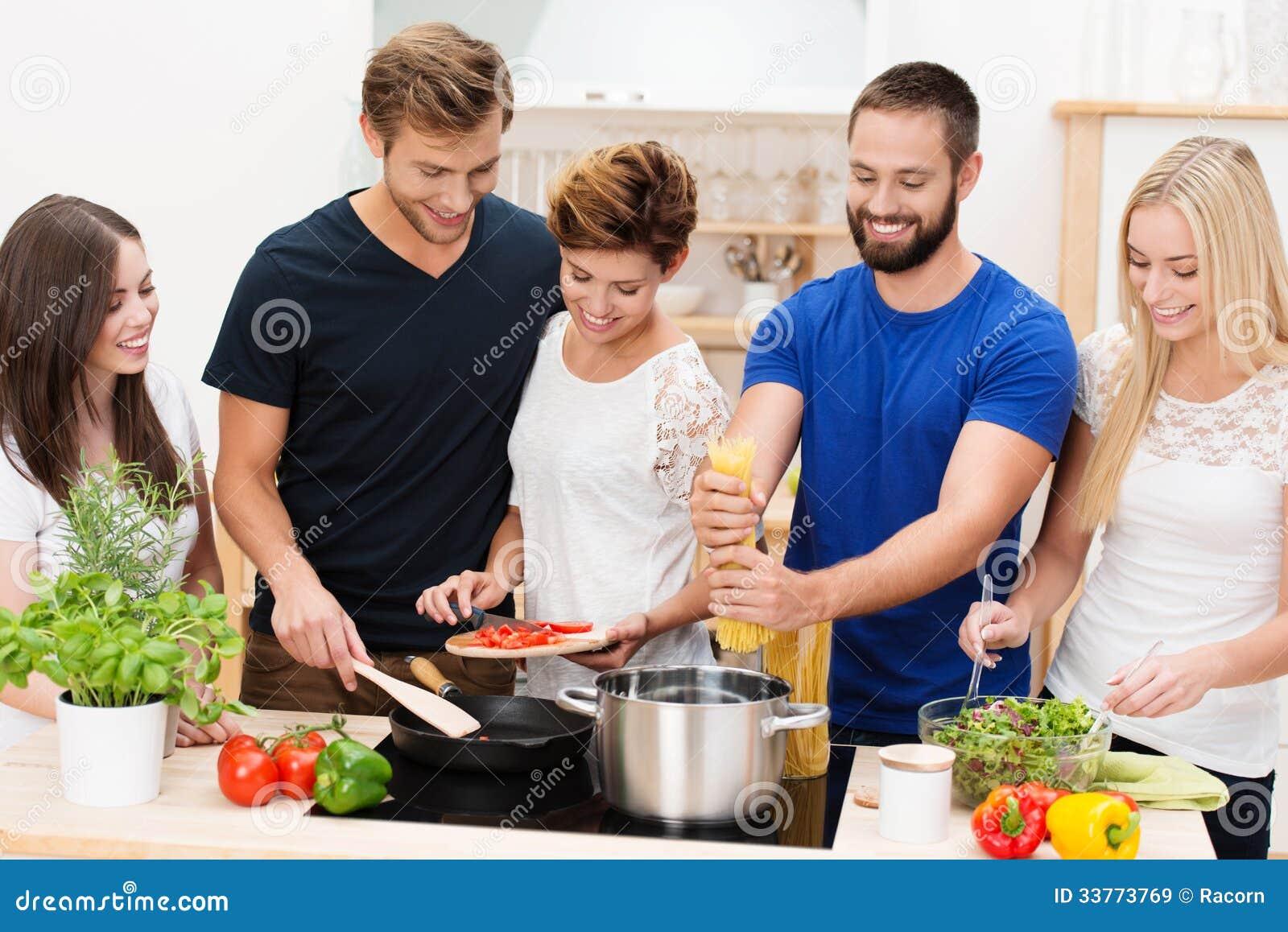 Group Of Friends Preparing Dinner Royalty Free Stock