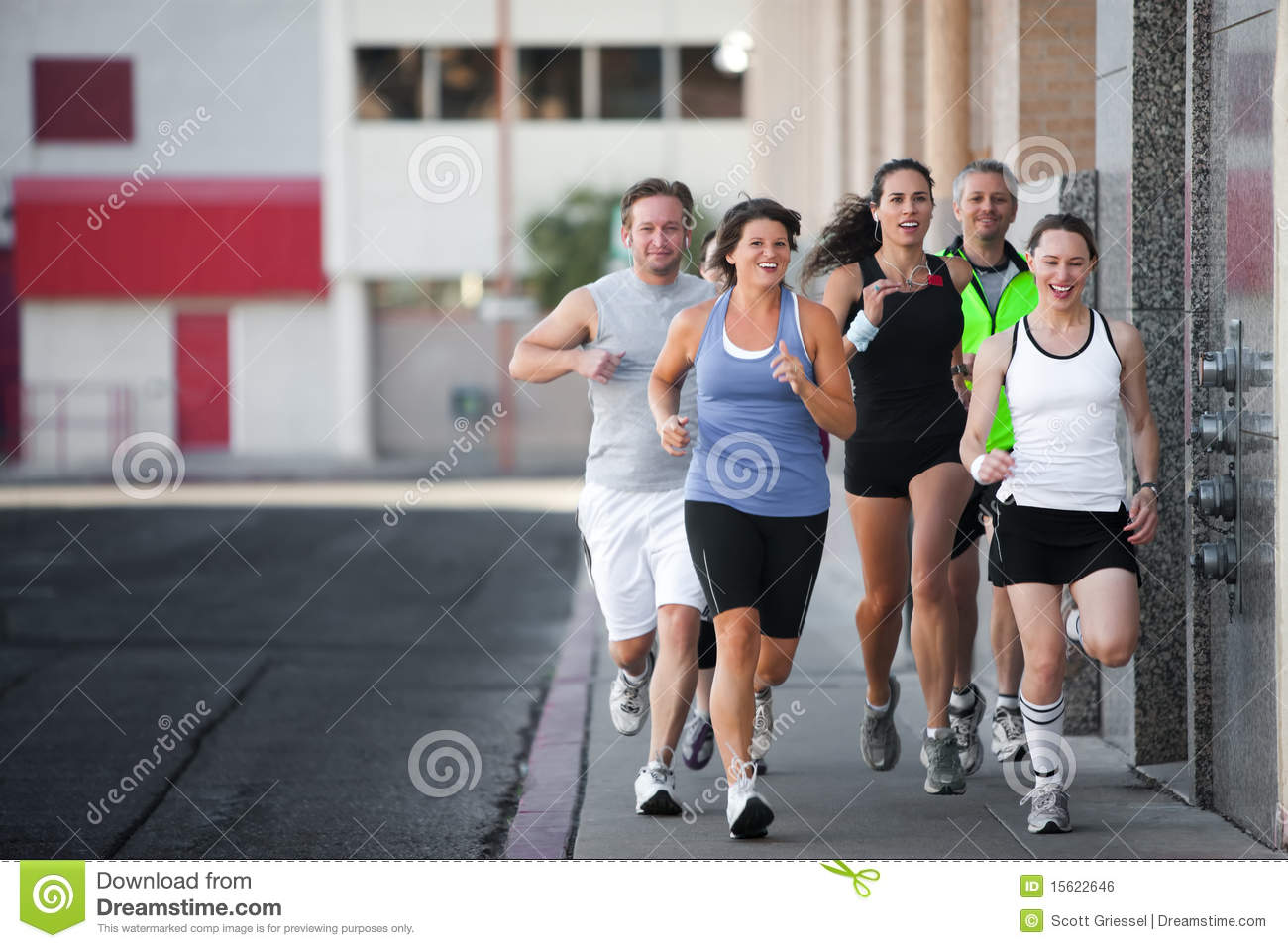 Group of friends runs downtown.