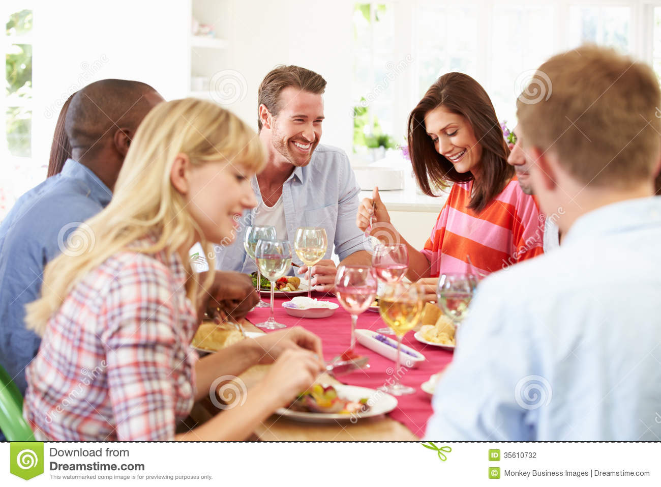 Group of friends sitting around table having dinner party for Eating table