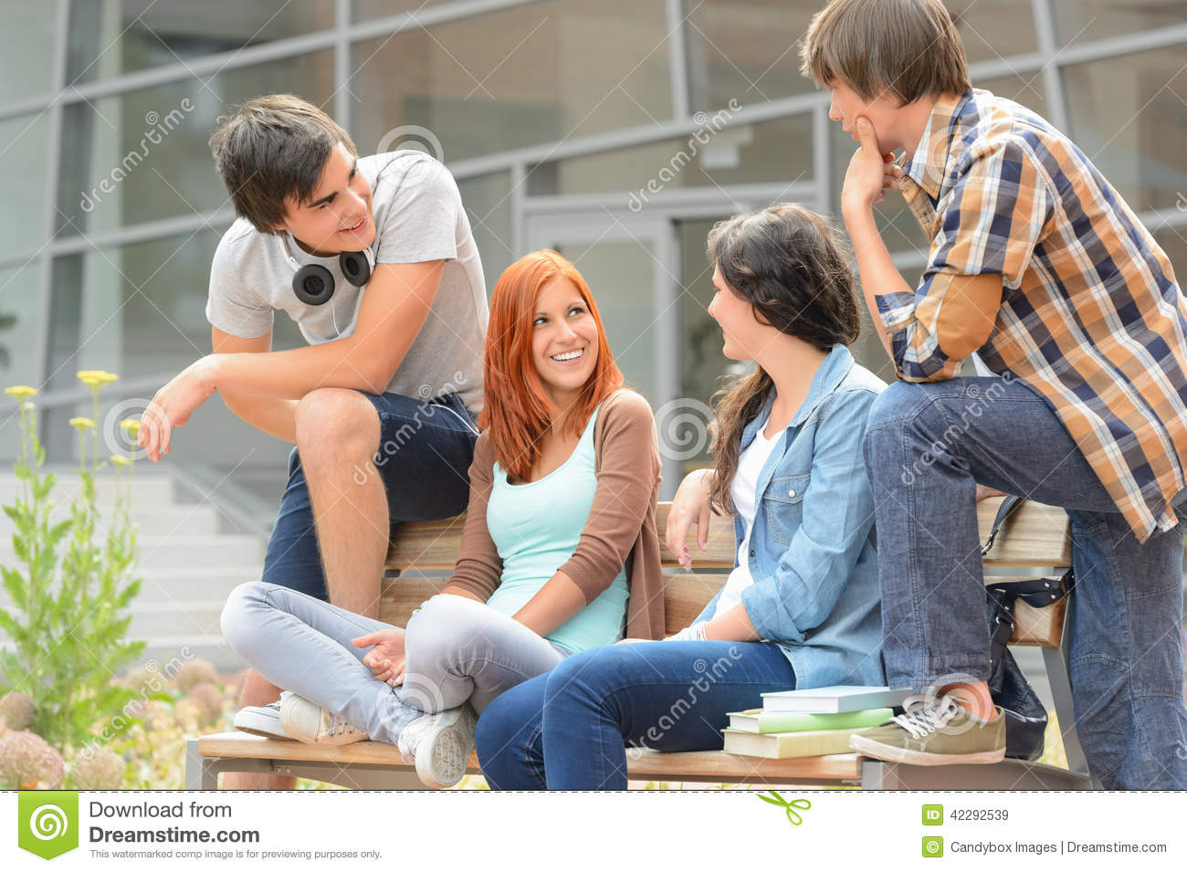 Group of friends sitting bench outside college stock photo for Hanging groups of pictures