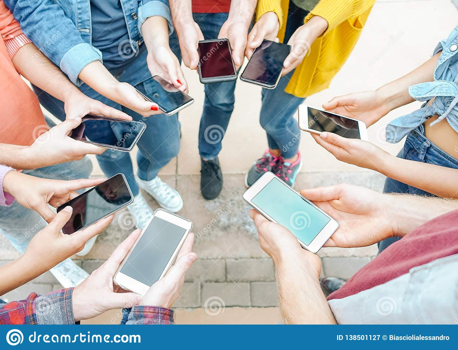Group of friends using their smart mobile phones - Millennial young people addicted to new technology trends