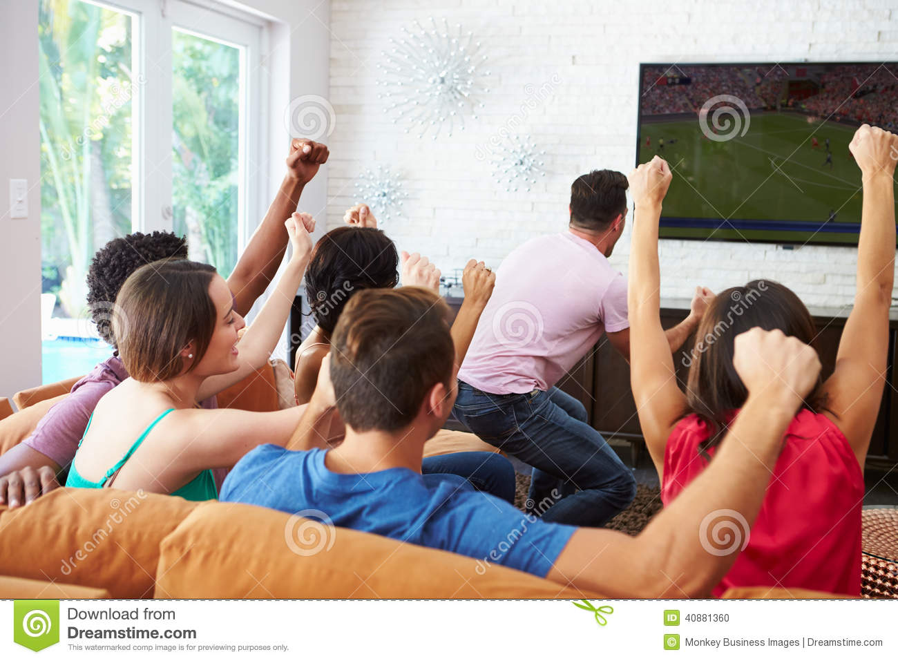 group-friends-watching-soccer-celebrating-goal-arms-air-cheering-40881360.jpg