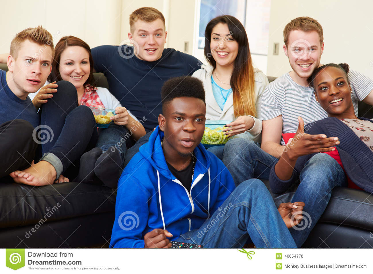 Group Of Friends Watching Television At Home Together