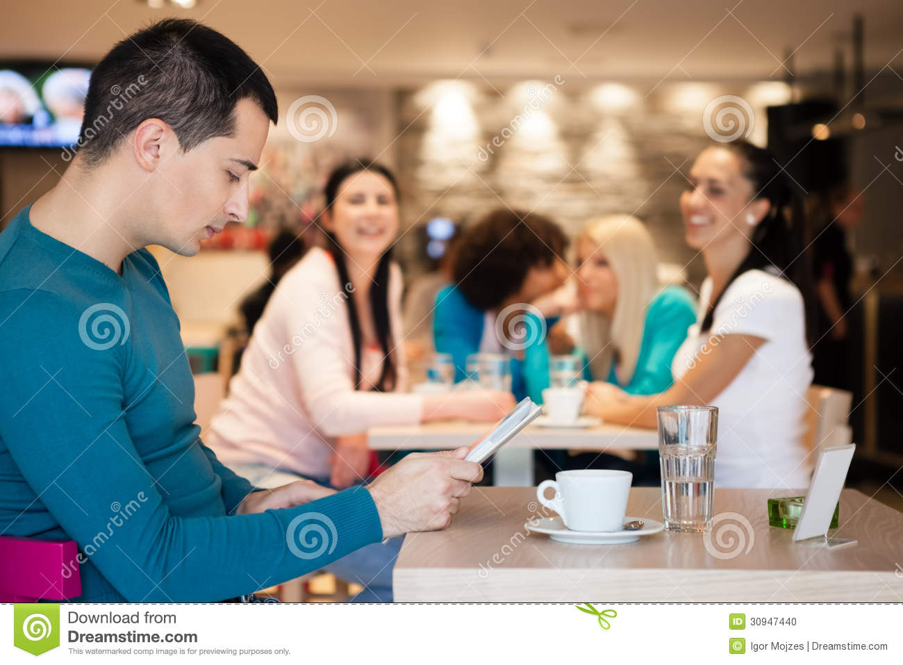 group of girl watching handsome man in cafe stock photo image group of girl watching handsome man in cafe