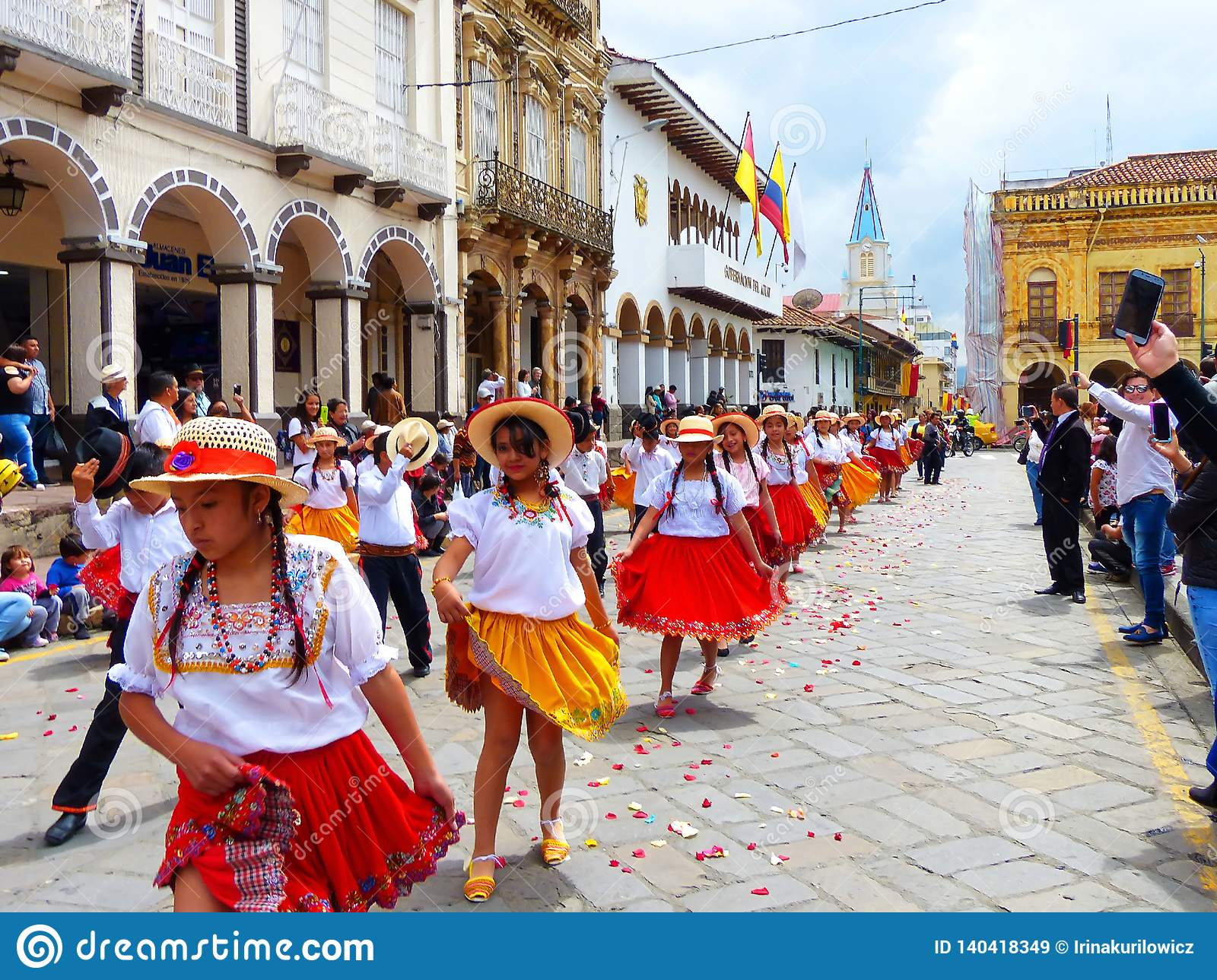 Group of girls dancers cuencanas at the parade at the historic center of city Cuenca