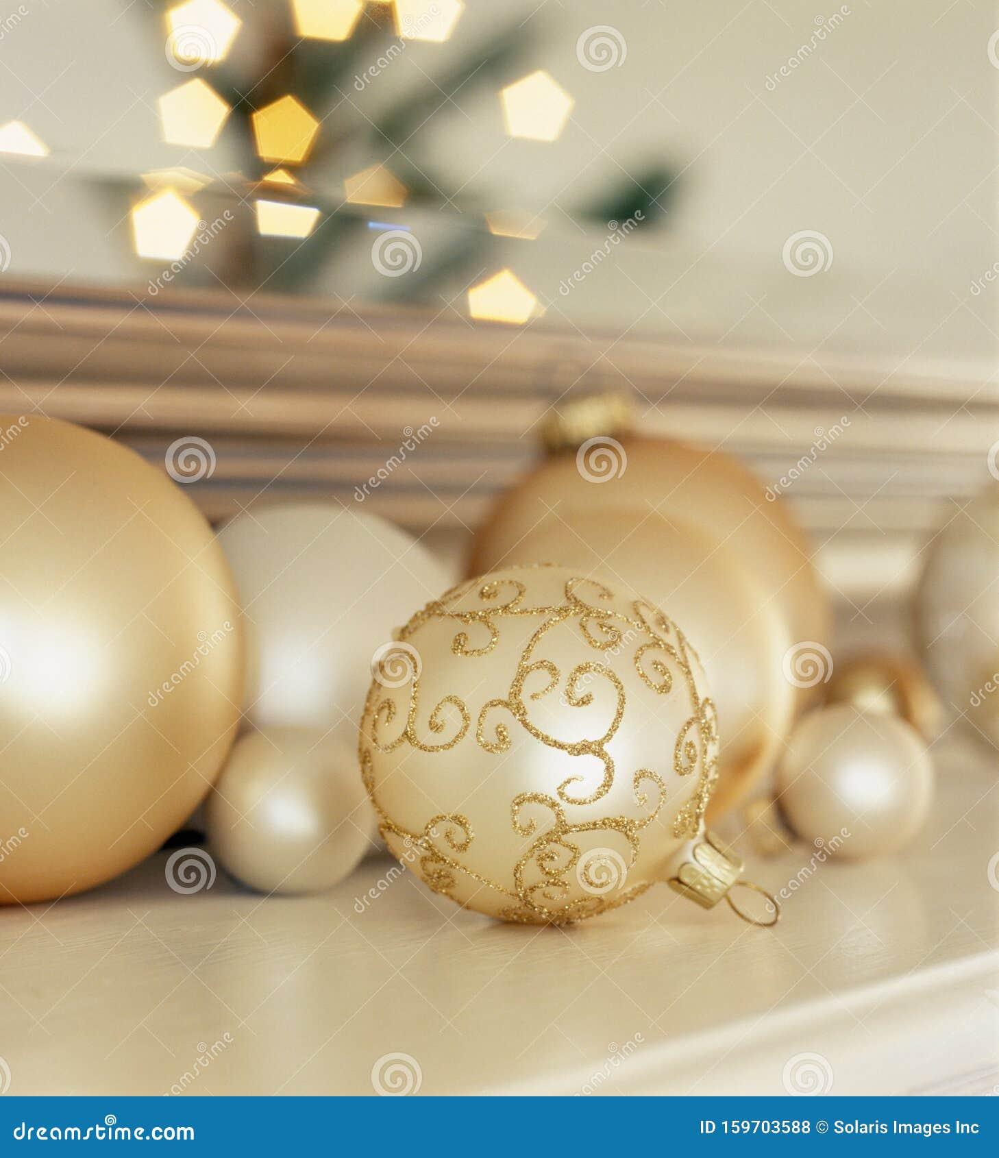 Group Of Glass Christmas Ornaments On Living Room Mantel