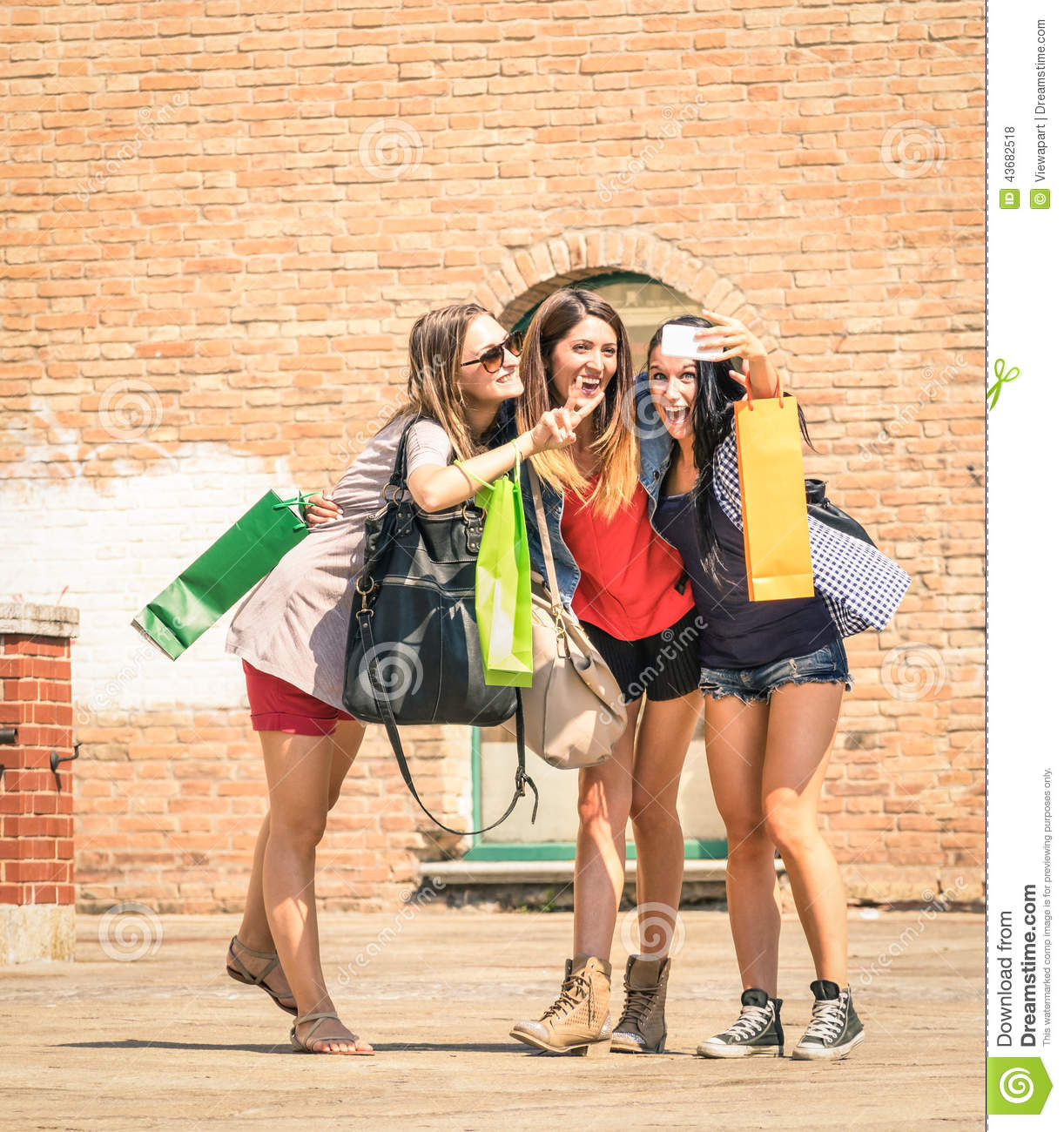 Group Of Happy Best Friends With Shopping Bags Taking A ...