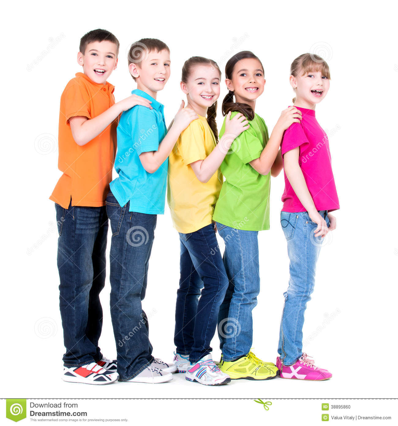 Group of happy children in colorful t shirts stand behind each other