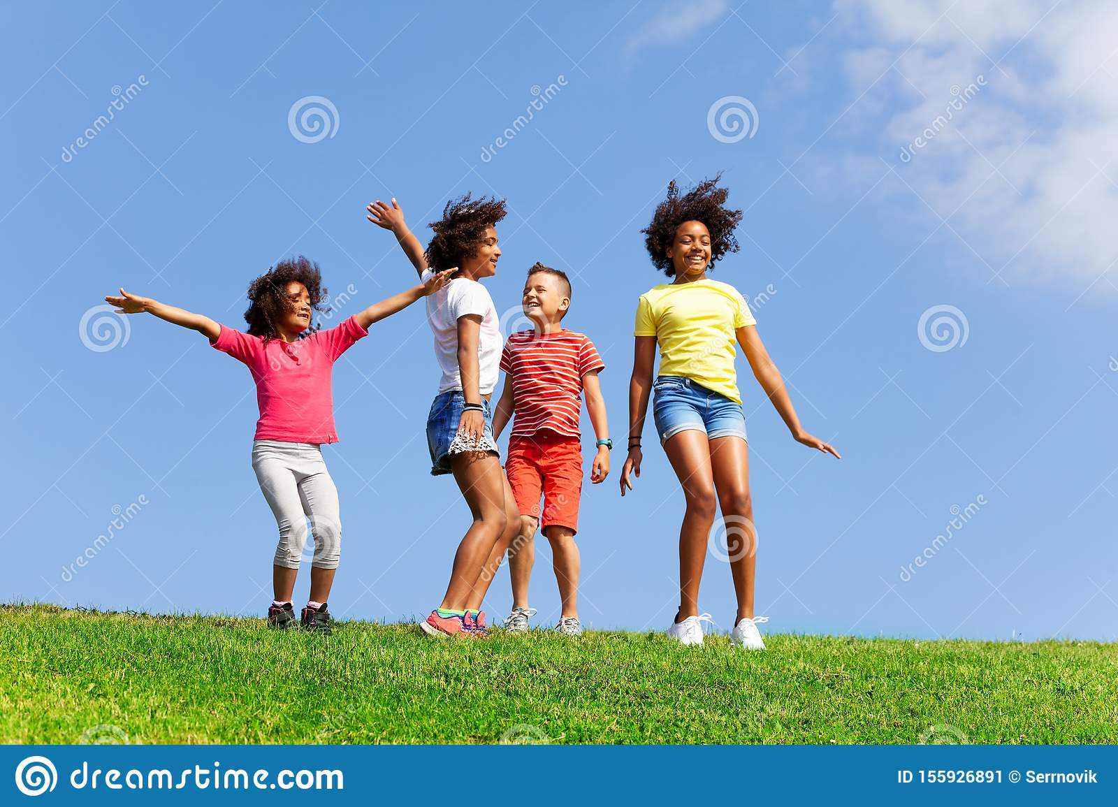 Group of happy dancing and jumping children