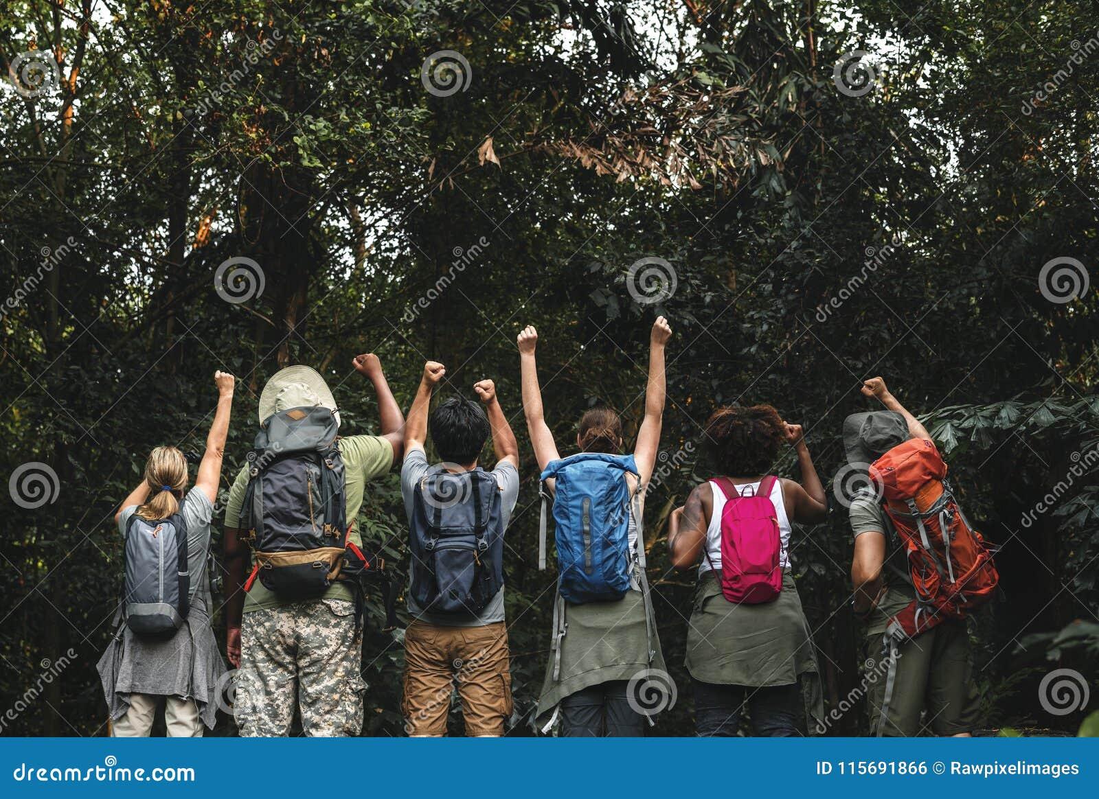 Group of happy diverse campers in trekking trip