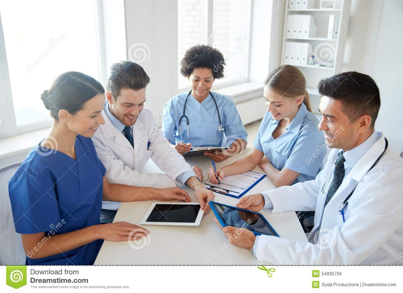 Group Of Happy Doctors Meeting At Hospital Office Stock ...