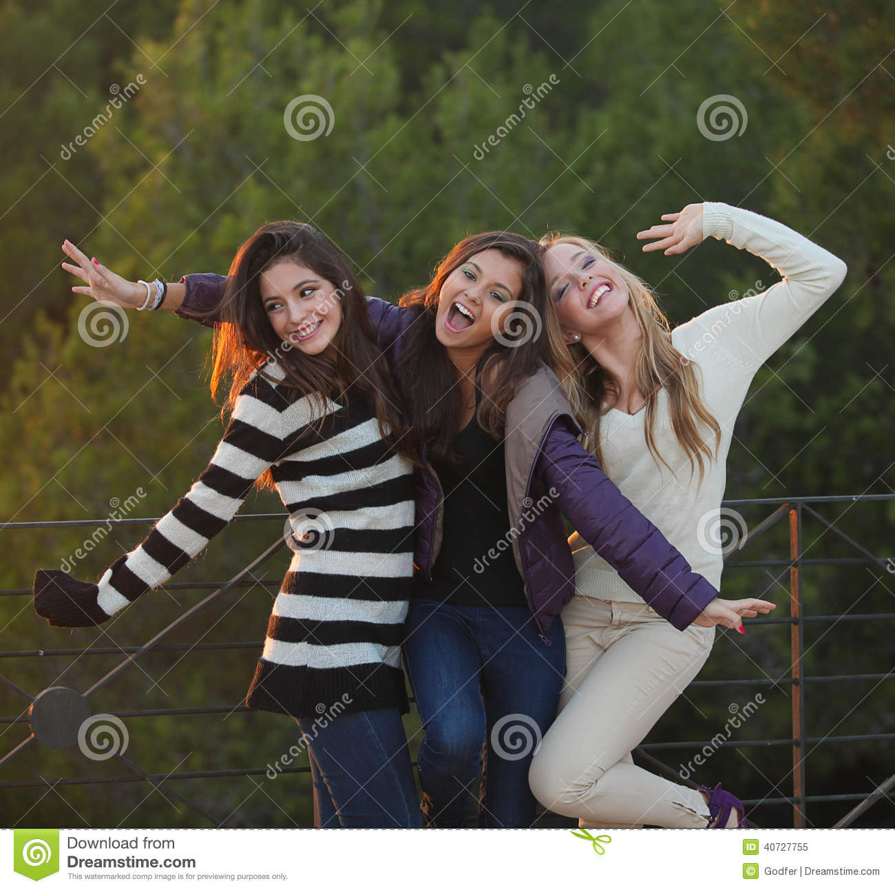 Group of happy friendly fashion teens