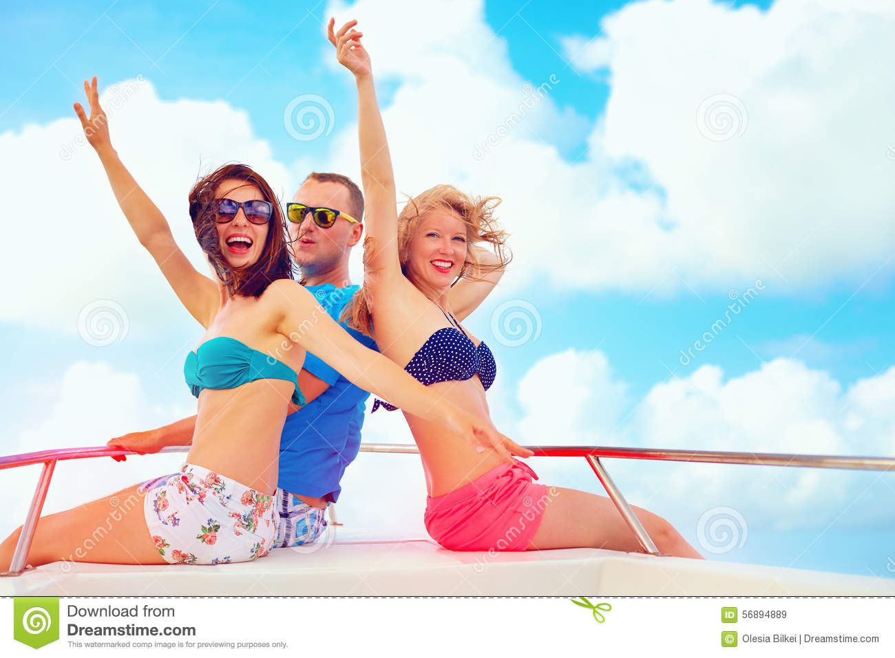 Group Of Happy Friends Having Fun On Yacht During Summer Vacation