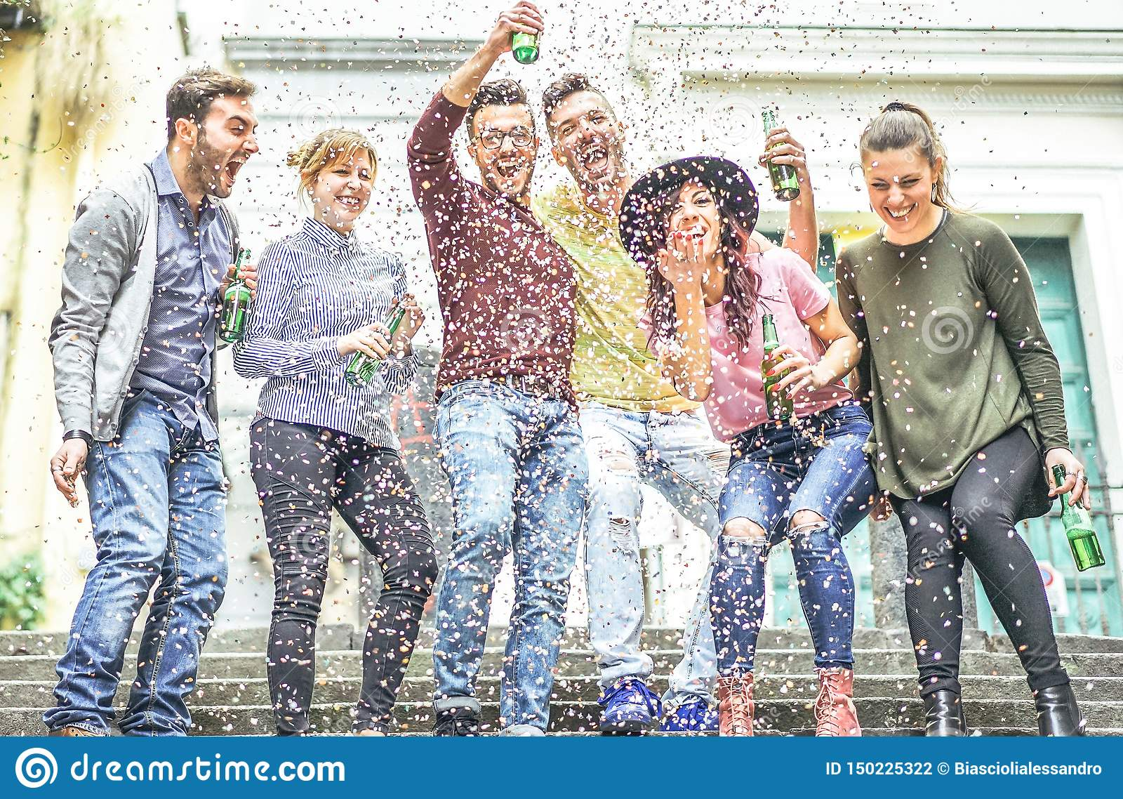 Group of happy friends making party on a urban area - Young people having fun laughing together and drinking beers outdoor