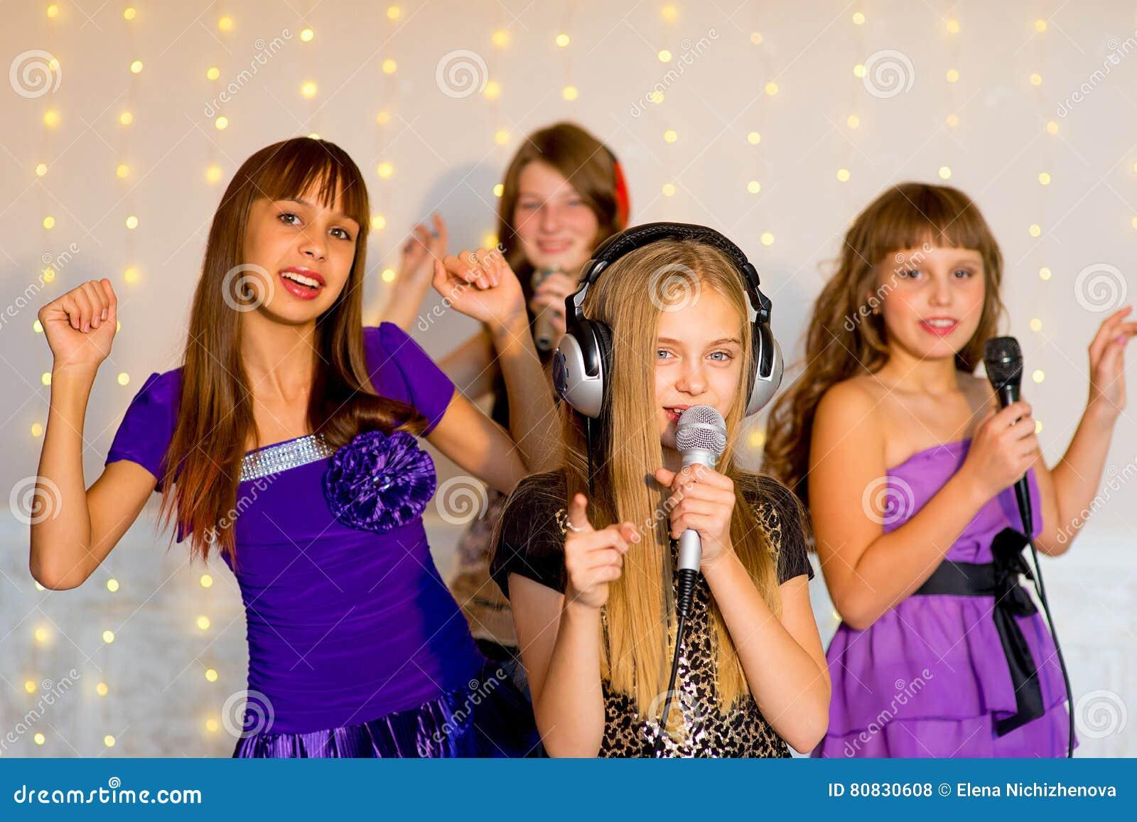 Group Of Happy Girls Singing On Karaoke Stock Photo - Image