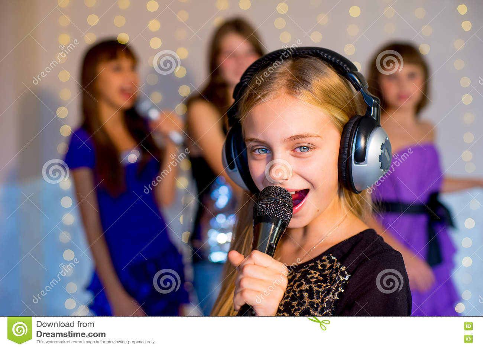 Group Of Happy Girls Singing On Karaoke Stock Image - Image