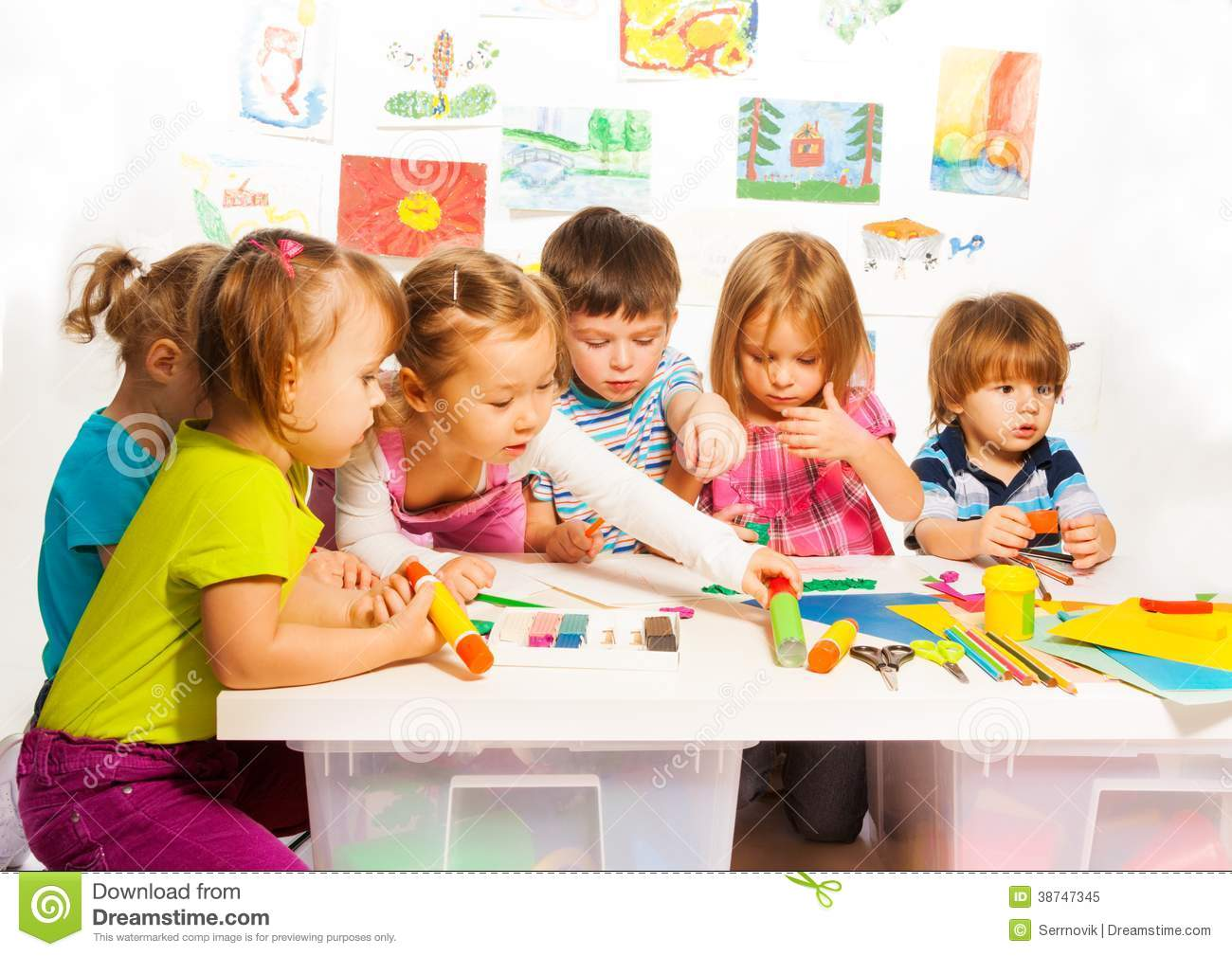 Group Of Happy Kids Painting And Stock Image - Image of gluing, glue ...
