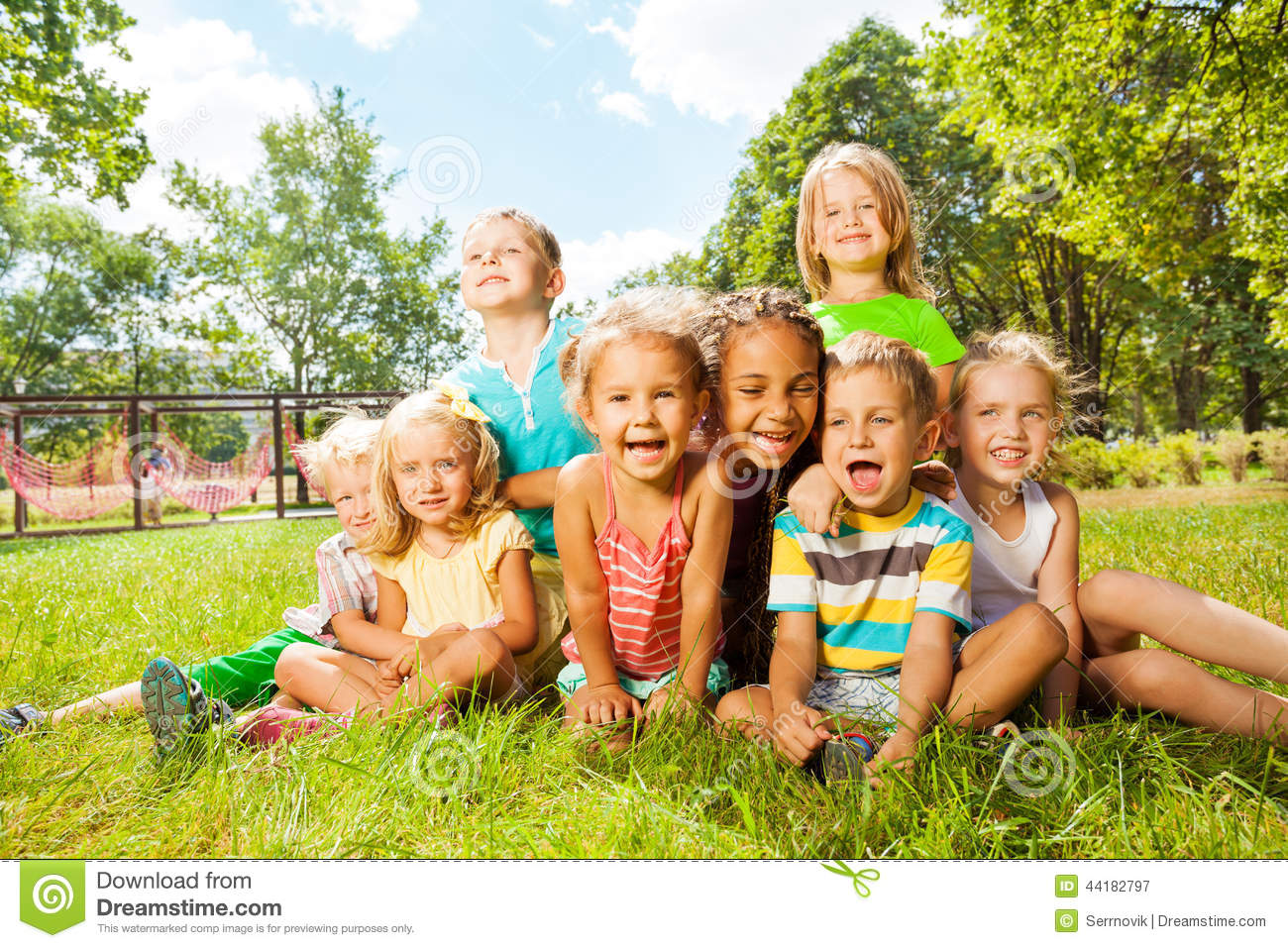 Group Of Happy Little Kids On The Lawn In Park Stock Photo ...