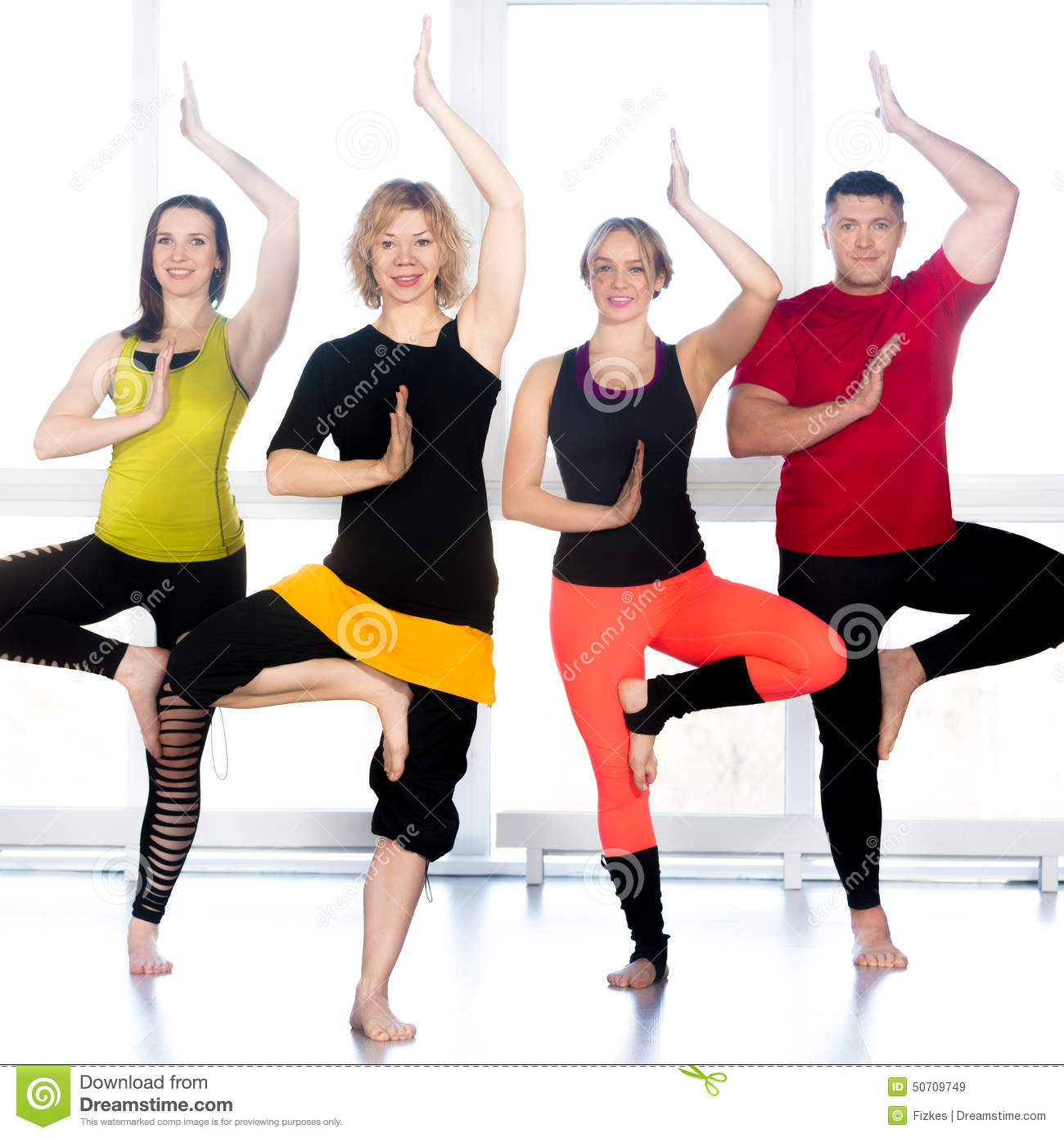Group Of Happy People Standing In Yoga Asana In Class Stock Image