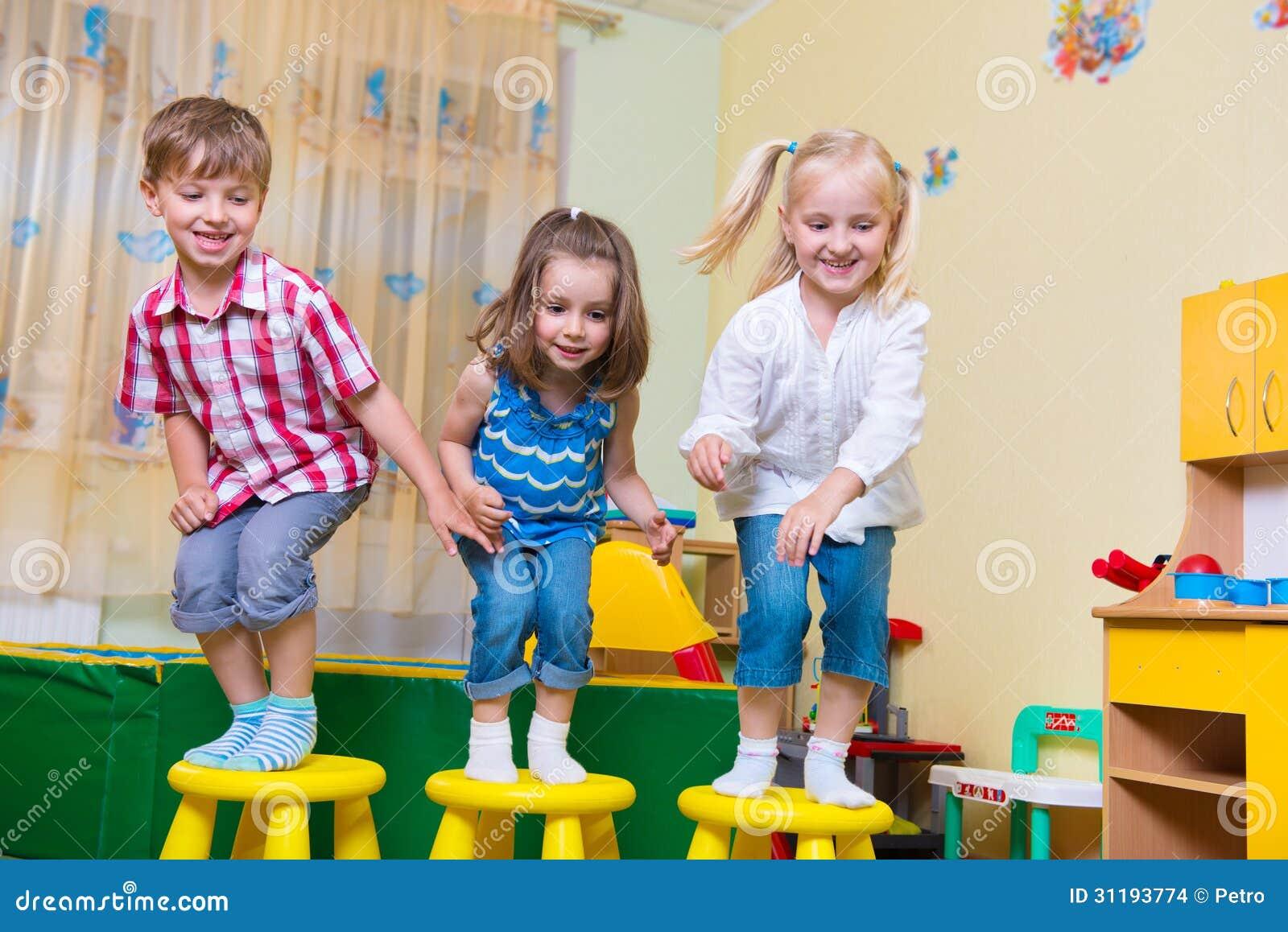 Worksheet Preschool Kindergarten group of happy preschool kids jumping stock images image 31193774 jumping