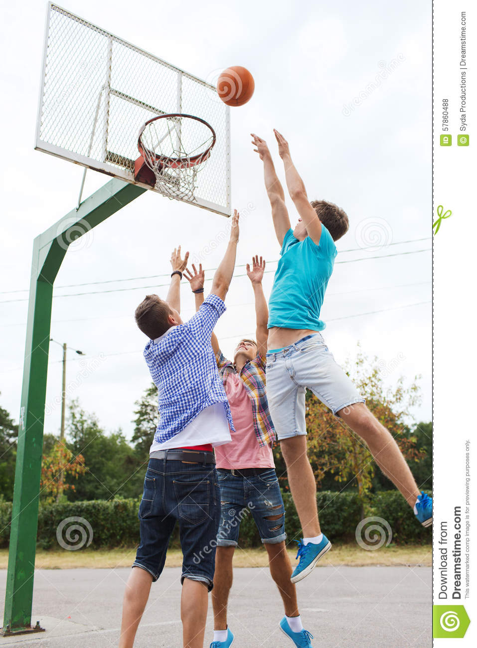 Group Of Happy Teenage Friends Playing Basketball Stock ...