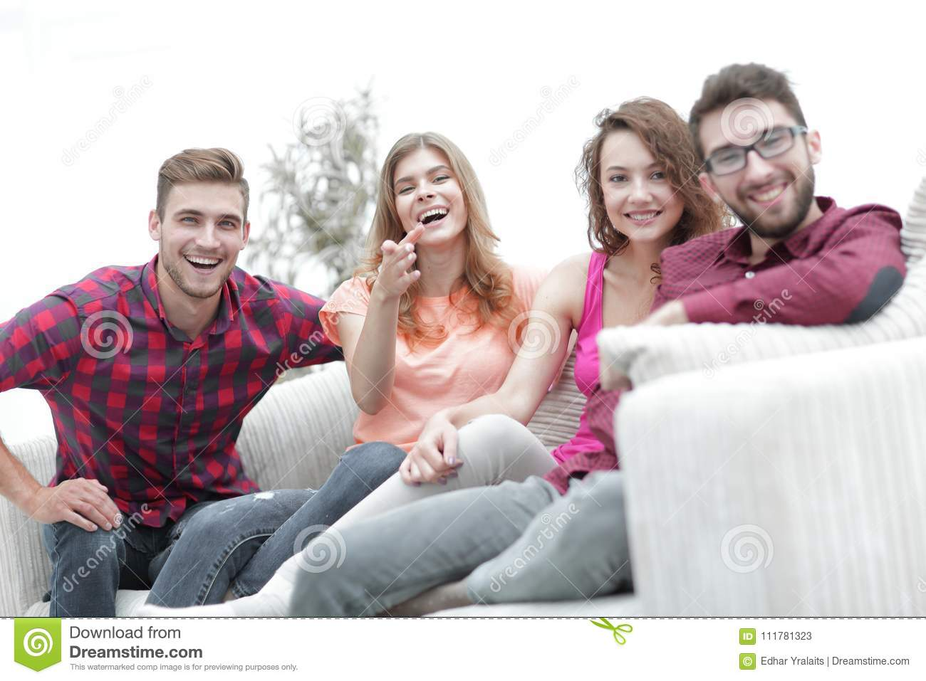 Group of happy young people sitting on the couch