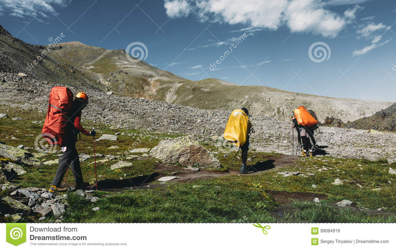 Hiking Team In Summer Mountains. Travel Destination Experience Lifestyle Concept