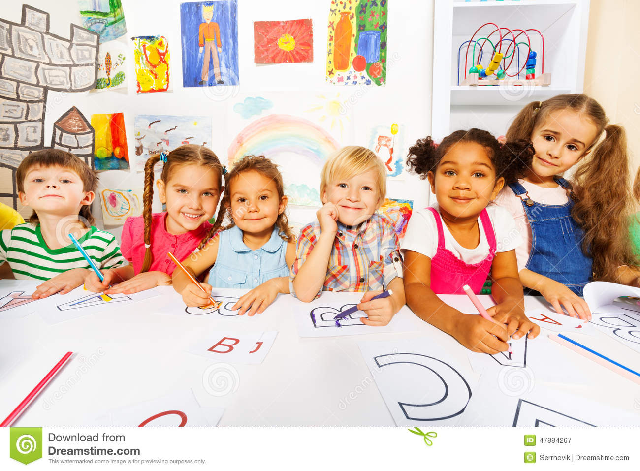 Kinder Garden: Group Of Kids, Boys And Girls In Reading Class Stock Image