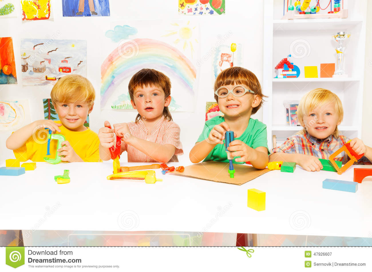 Kinder Garden: Group Of Kids In The Class With Toy Tools Stock Photo