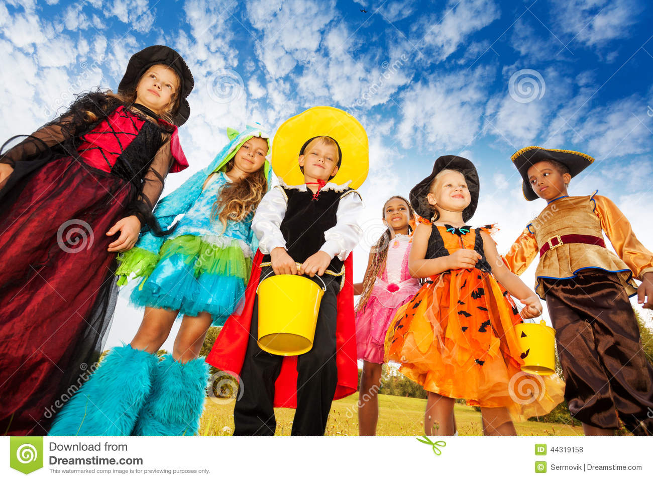 Friend Group Halloween Costumes Kids.Group Of Kids In Halloween Costumes Looks Down Stock Photo