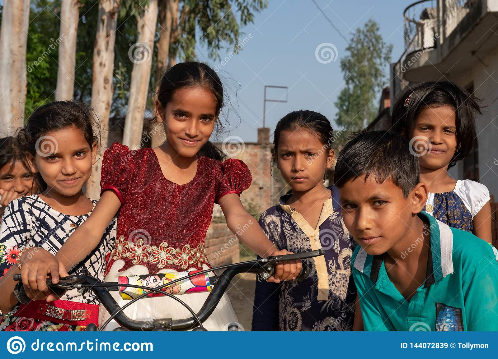 Bhadarsa, Uttar Pradesh / India - April 2, 2019: A group of kids pose for a photo outside of their village near Bhadarsa.