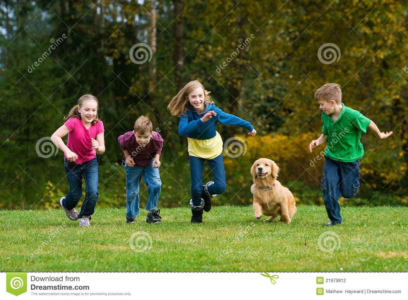 A group of kids racing on grass