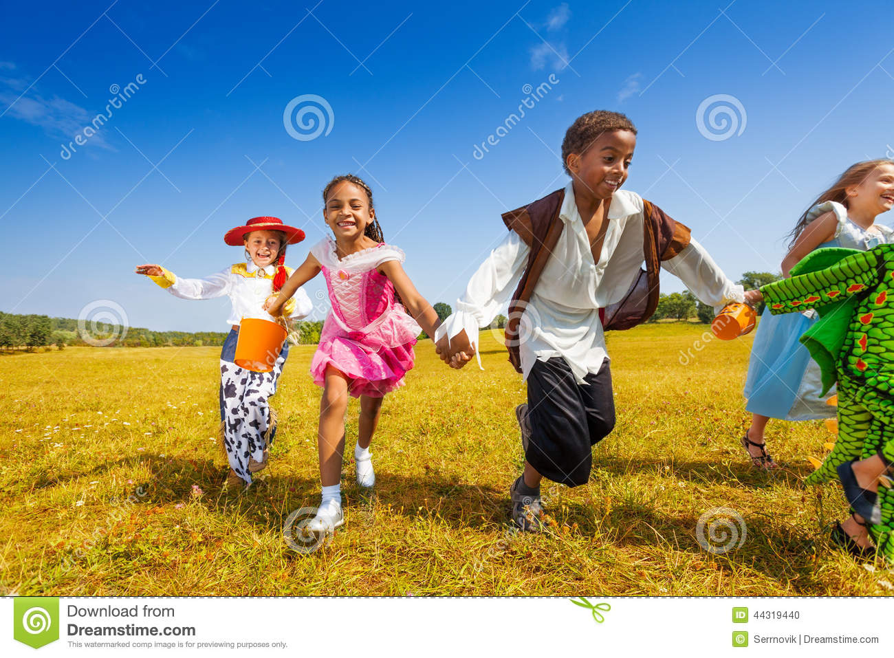 Friend Group Halloween Costumes Kids.Group Of Kids Running In Halloween Costumes Stock Photo