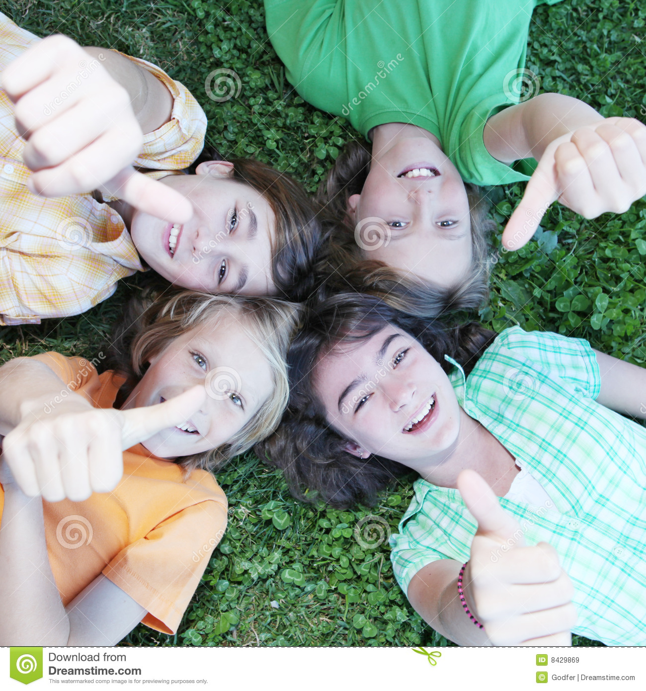 Group of kids with thumbs up