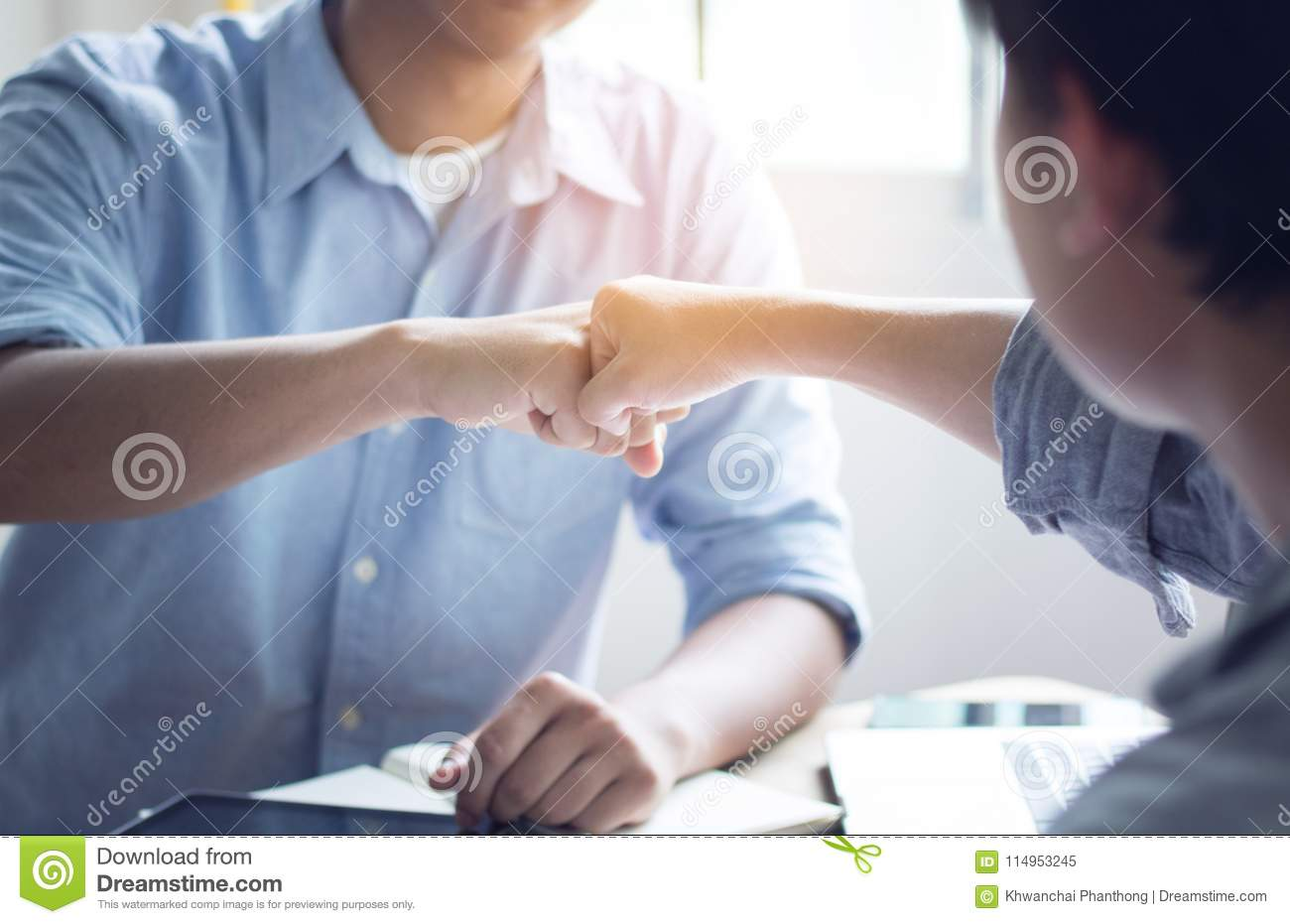 Group of man punch in office, teamwork concept
