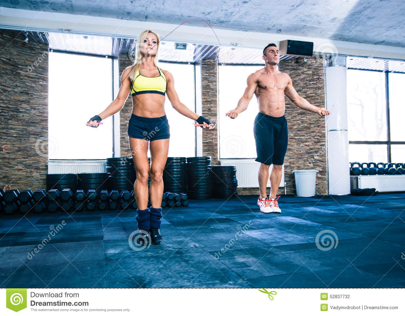 Group of a man and woman workout with jumping rope