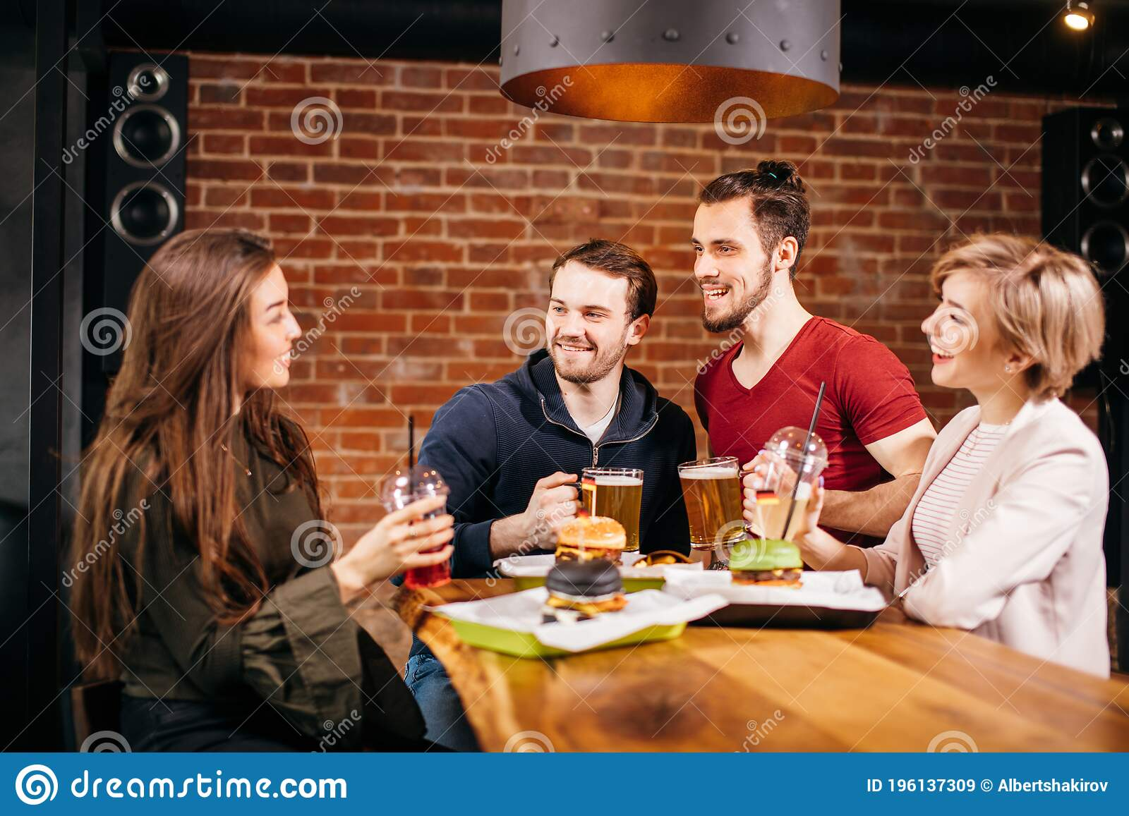 Group Of Mates Enjoying Night Out At Burger Bar Stock Image Image Of Happy Horizontal 196137309