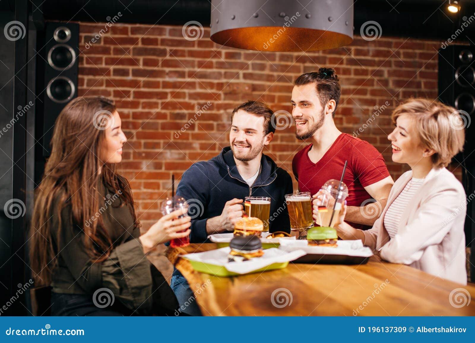 Group Of Mates Enjoying Night Out At Burger Bar Stock Image Image Of Happy Horizontal 196137309