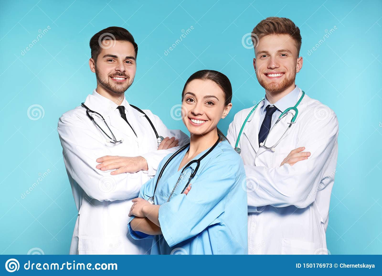 Group of medical doctors on color background