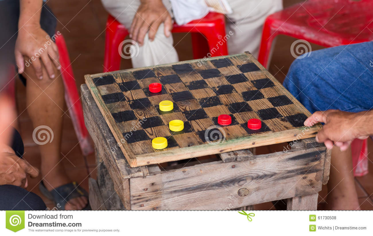 group of men are having fun playing checker