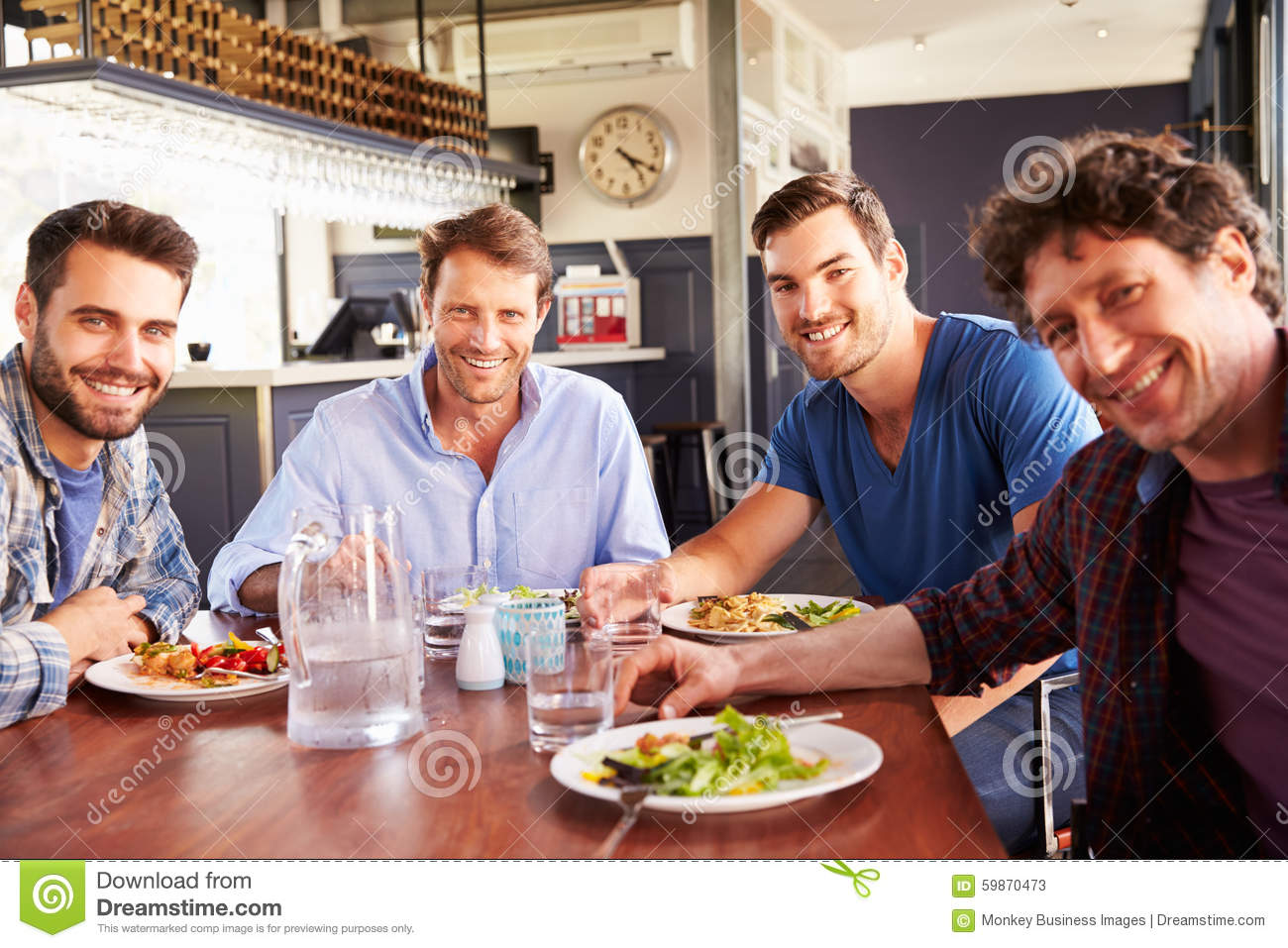 A group of men having lunch in a restaurant stock photo for Group lunch