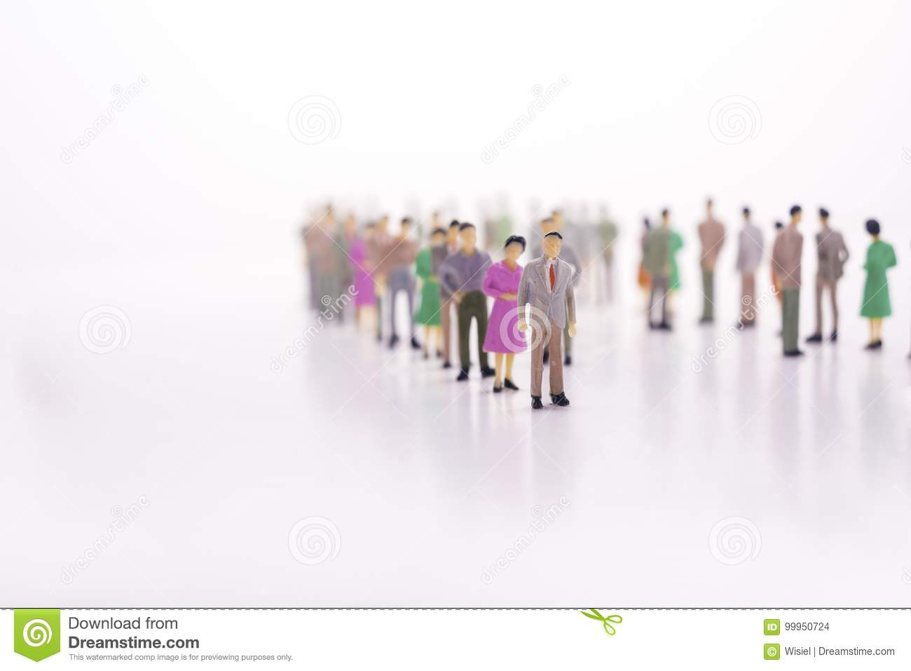 Group of miniature people over white background standing in line