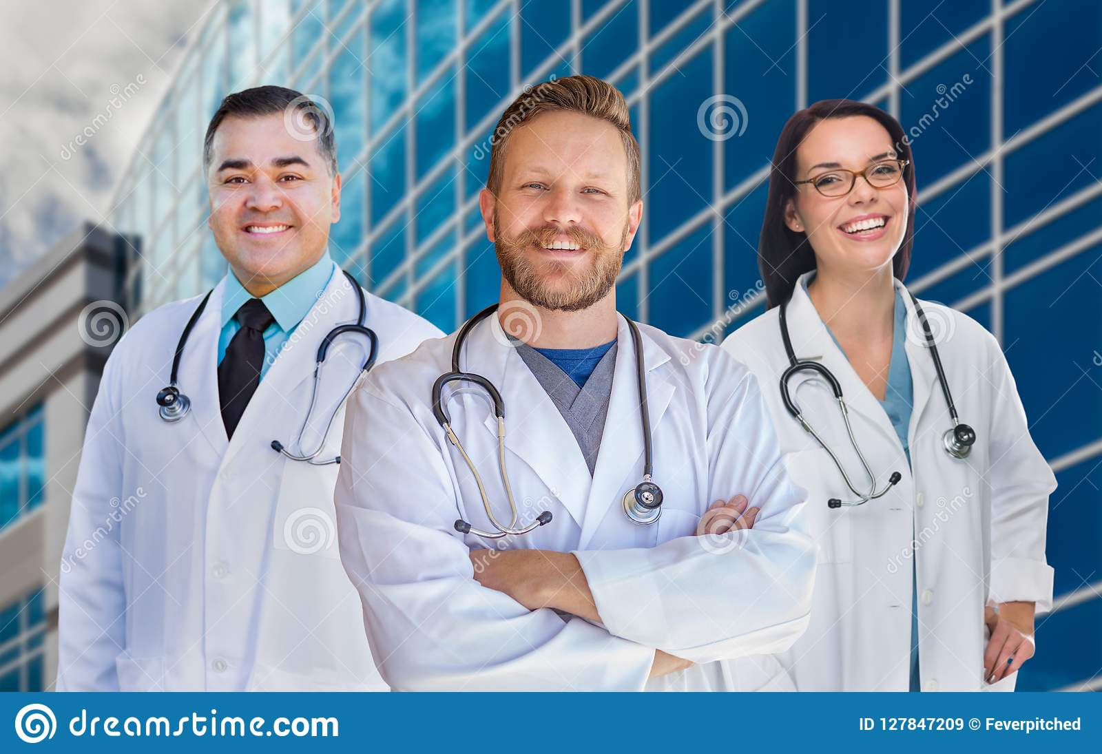 Group Of Mixed Race Male and Female Doctors or Nurses by Hospital