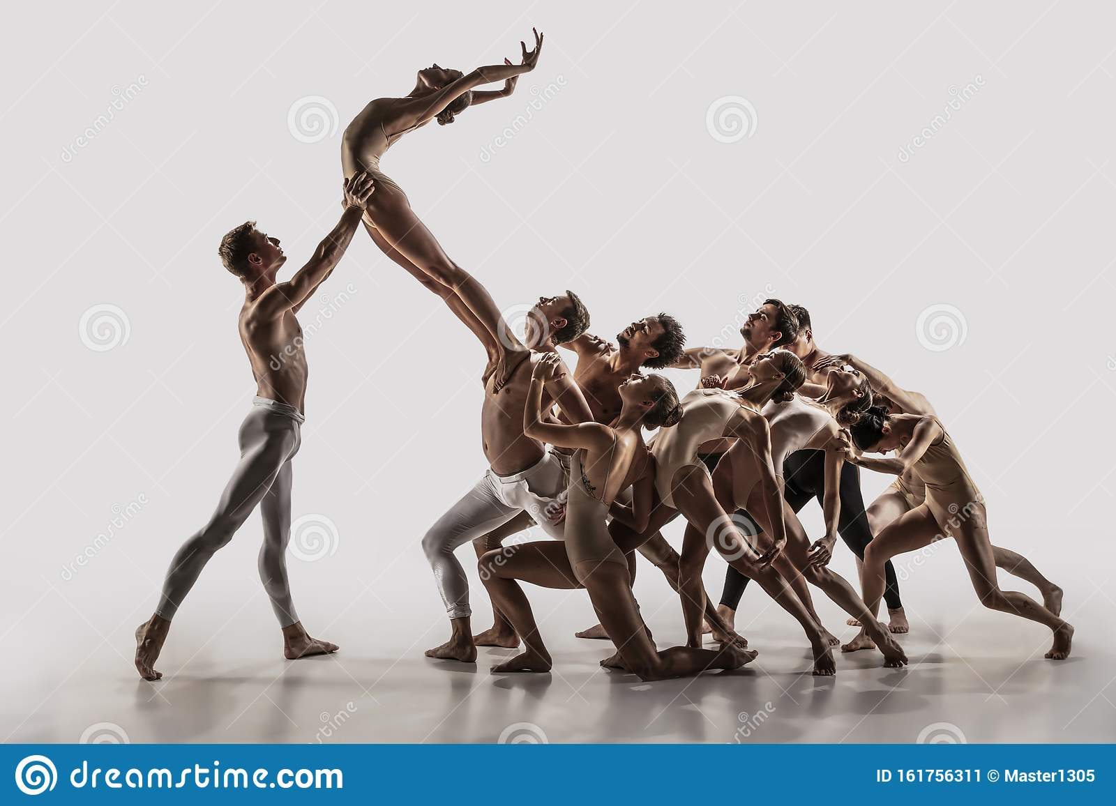 The Group Of Modern Ballet Dancers. Contemporary Art Ballet. Young Flexible  Athletic Men And Women. Stock Image - Image of dancer, beautiful: 161756311