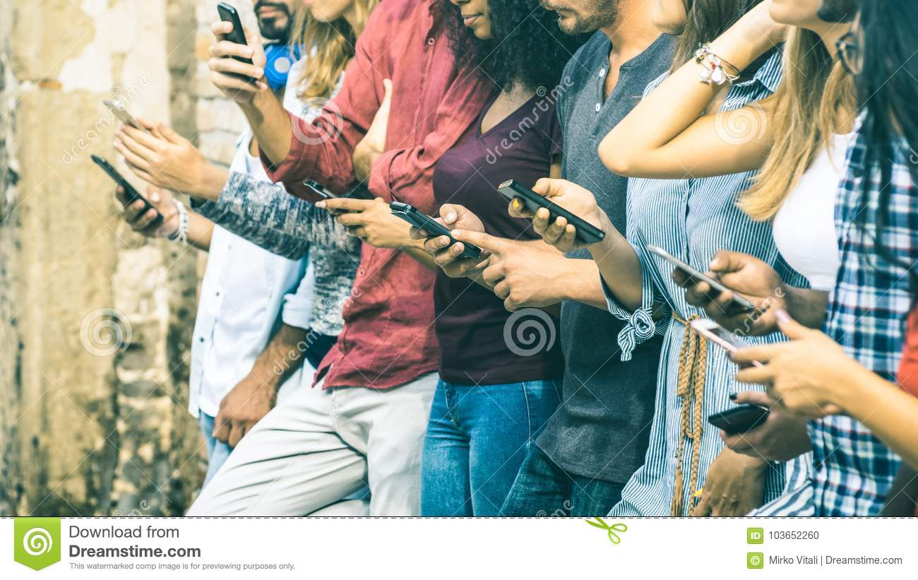Group of multicultural friends using mobile smart phone