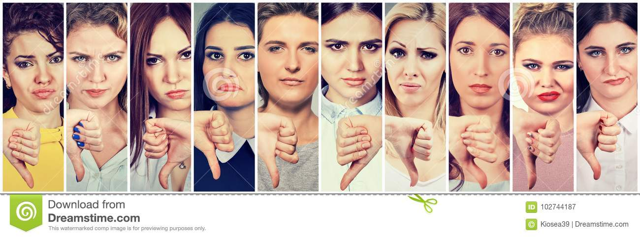 Group of multicultural young women making thumbs down gesture for disagreement